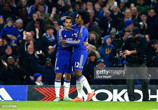 Willian of Chelsea is congratulated on his goal by Team mate Pedro during the Barclays Premier League match between Chelsea and Newcastle at Stamford...