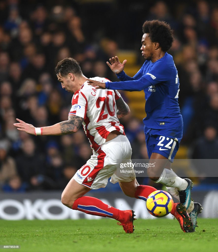 Willian of Chelsea is fouled by Geoff Cameron of Stoke City and consequently awarded a penalty during the Premier League match between Chelsea and Stoke City at Stamford Bridge on December 30, 2017 in London, England.