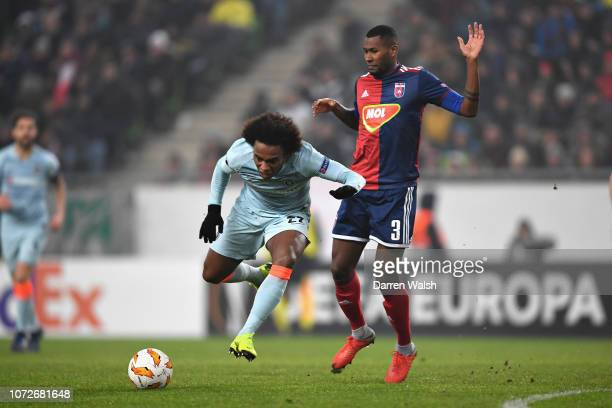 Willian of Chelsea is fouled by Paulo Vinicius of Vidi FC leading to a free kick during the UEFA Europa League Group L match between Vidi FC and...