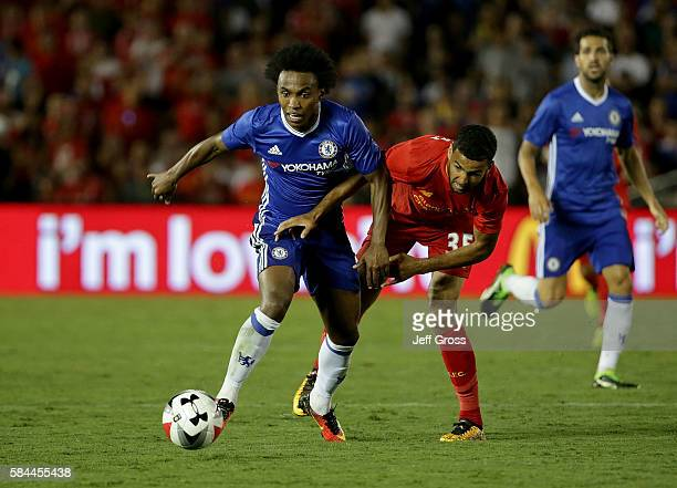 Willian of Chelsea is pursued by Kevin Stewart of Liverpool during the 2016 International Champions Cup at Rose Bowl on July 27 2016 in Pasadena...