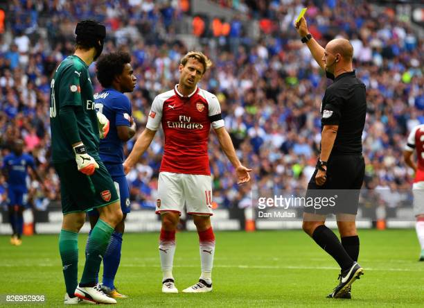 Willian of Chelsea is shown a yellow card by Referee Bobby Madley during the The FA Community Shield final between Chelsea and Arsenal at Wembley...