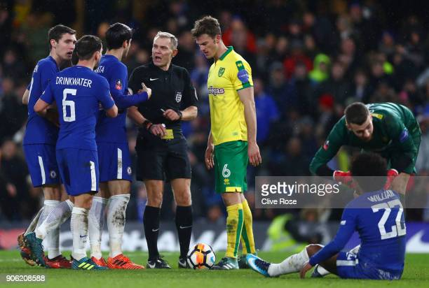 Willian of Chelsea is shown a yellow card during The Emirates FA Cup Third Round Replay between Chelsea and Norwich City at Stamford Bridge on...