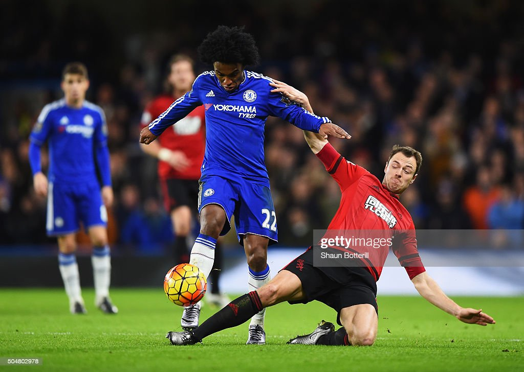 Willian of Chelsea is tackled by Jonny Evans of West Bromwich Albion during the Barclays Premier League match between Chelsea and West Bromwich Albion at Stamford Bridge on January 13, 2016 in London, England.