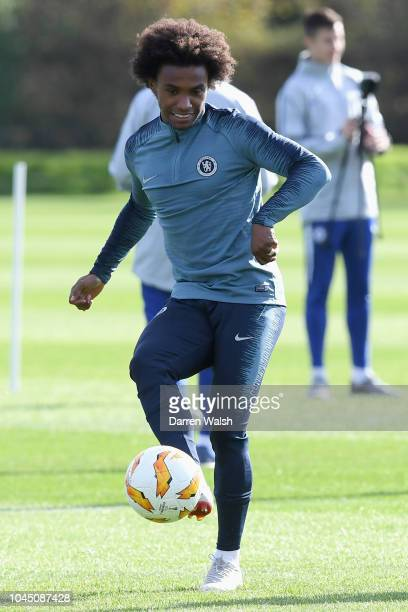 Willian of Chelsea kicks the ball during a training session at Chelsea Training Ground on October 3 2018 in Cobham England