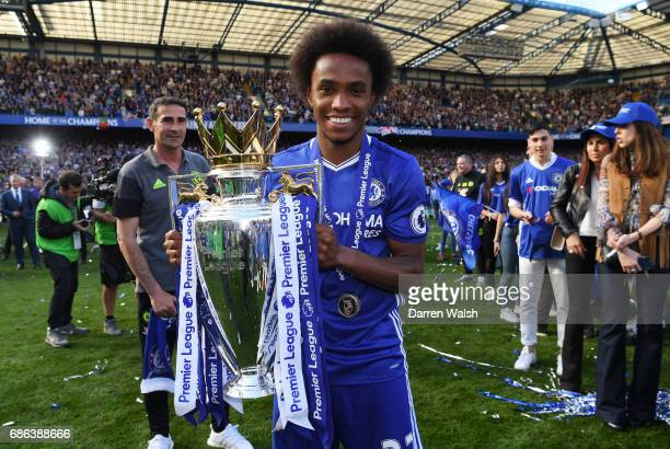 Willian of Chelsea poses with the Premier League Trophy after the Premier League match between Chelsea and Sunderland at Stamford Bridge on May 21...