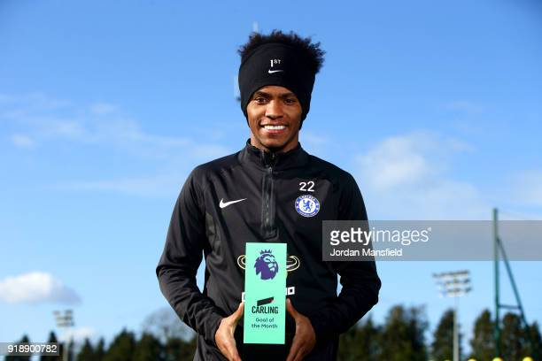 Willian of Chelsea poses with the trophy for Carling Premier League Goal of the Month for January 2018 at Chelsea Training Ground on February 15 2018...
