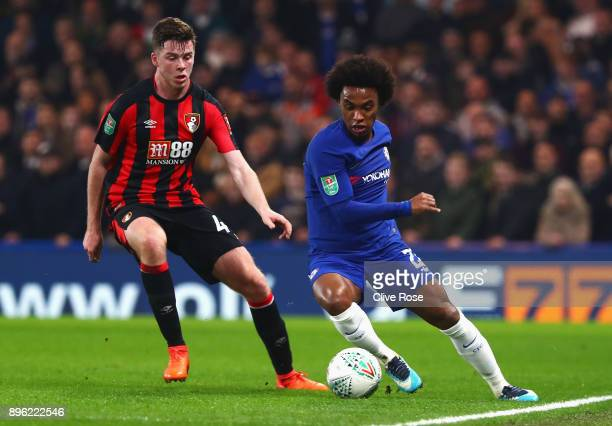 Willian of Chelsea runs with the ball away from Jack Simpson of AFC Bournemouth during the Carabao Cup QuarterFinal match between Chelsea and AFC...