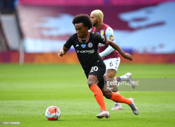 Willian of Chelsea runs with the ball during the Premier League match between Aston Villa and Chelsea FC at Villa Park on June 21 2020 in Birmingham...