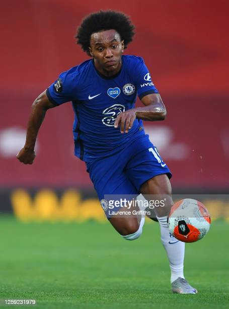 Willian of Chelsea runs with the ball during the Premier League match between Liverpool FC and Chelsea FC at Anfield on July 22, 2020 in Liverpool,...