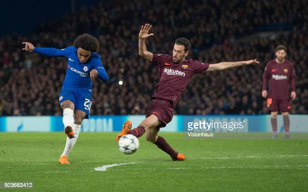 Willian of Chelsea scores for Chelsea as Sergio Busquets of Barcelona fails to block the shot during the UEFA Champions League Round of 16 First Leg...