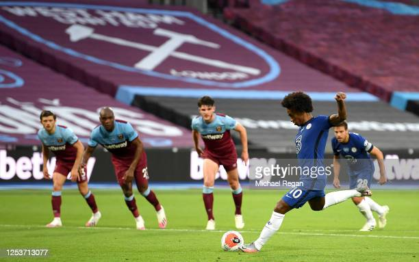 Willian of Chelsea scores his sides first goal during the Premier League match between West Ham United and Chelsea FC at London Stadium on July 01,...