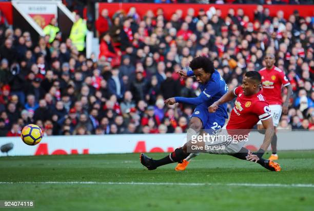 Willian of Chelsea scores his sides first goal during the Premier League match between Manchester United and Chelsea at Old Trafford on February 25...