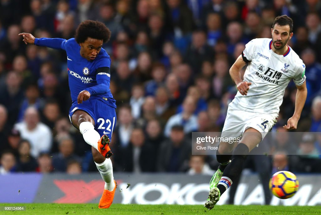 Willian of Chelsea scores his sides first goal during the Premier League match between Chelsea and Crystal Palace at Stamford Bridge on March 10, 2018 in London, England.