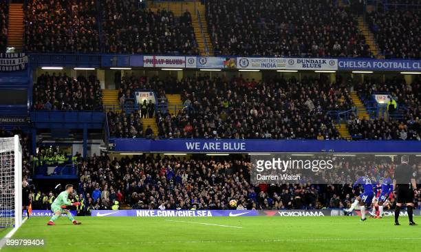 Willian of Chelsea scores his sides fourth goal from the penalty spot during the Premier League match between Chelsea and Stoke City at Stamford...
