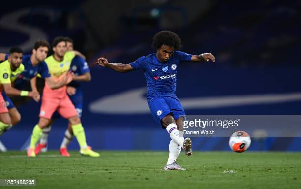 Willian of Chelsea scores his sides second goal during the Premier League match between Chelsea FC and Manchester City at Stamford Bridge on June 25...