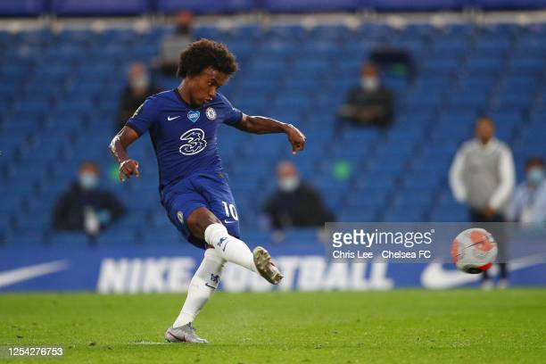 Willian of Chelsea scores his team's first goal from the penalty spot during the Premier League match between Chelsea FC and Watford FC at Stamford...