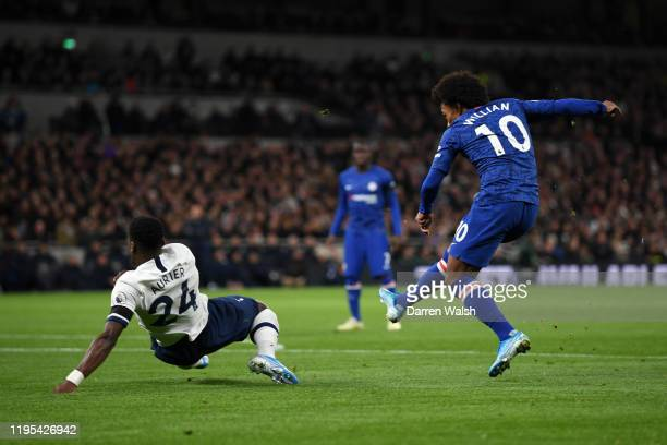 Willian of Chelsea scores his team's first goal past Serge Aurier of Tottenham Hotspur during the Premier League match between Tottenham Hotspur and...