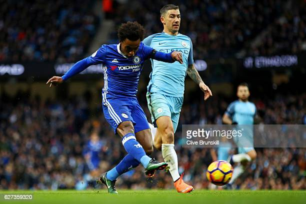 Willian of Chelsea scores his team's second goal during the Premier League match between Manchester City and Chelsea at Etihad Stadium on December 3...