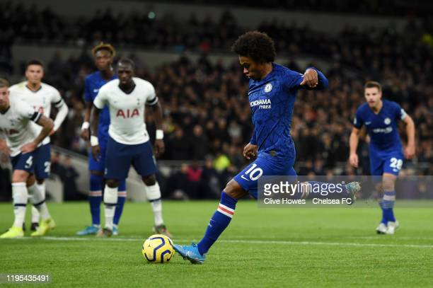 Willian of Chelsea scores his team's second goal from the penalty spot during the Premier League match between Tottenham Hotspur and Chelsea FC at...