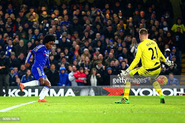 Willian of Chelsea scores his team's third goal past Robert Elliot of Newcastle United during the Barclays Premier League match between Chelsea and...