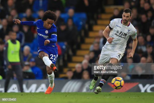 Willian of Chelsea scores the opening goal during the Premier League match between Chelsea and Crystal Palace at Stamford Bridge on March 10 2018 in...