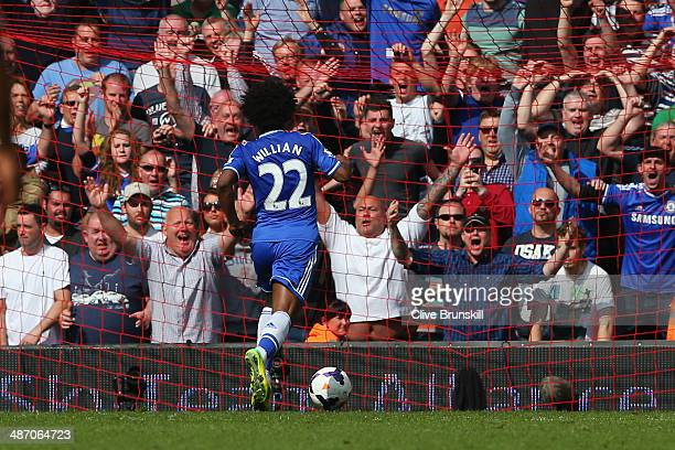 Willian of Chelsea scores their second goal during the Barclays Premier League match between Liverpool and Chelsea at Anfield on April 27 2014 in...