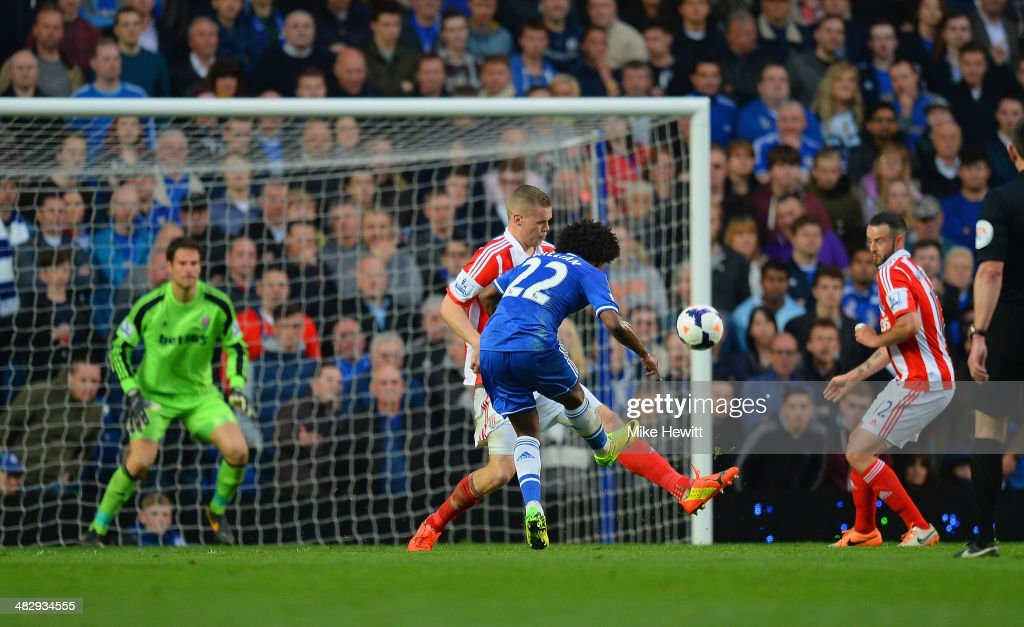 Willian of Chelsea scores their third goal during the Barclays Premier League match between Chelsea and Stoke City at Stamford Bridge on April 5, 2014 in London, England.