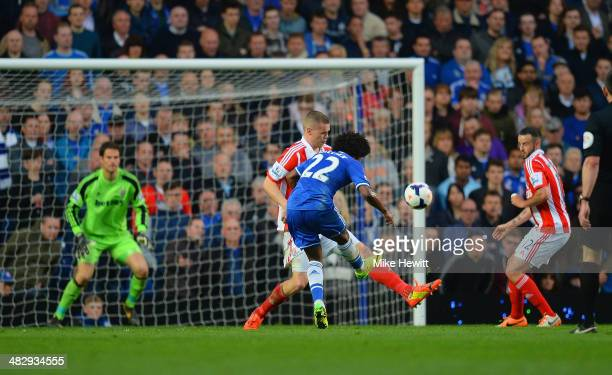 Willian of Chelsea scores their third goal during the Barclays Premier League match between Chelsea and Stoke City at Stamford Bridge on April 5 2014...