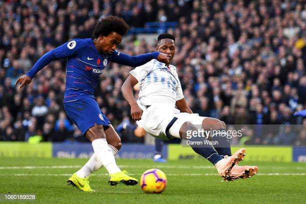 Willian of Chelsea shoots under pressure from Yerry Mina of Everton during the Premier League match between Chelsea FC and Everton FC at Stamford...