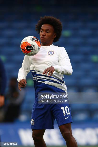 Willian of Chelsea shows some skills as he warms up during the Premier League match between Chelsea FC and Watford FC at Stamford Bridge on July 04...