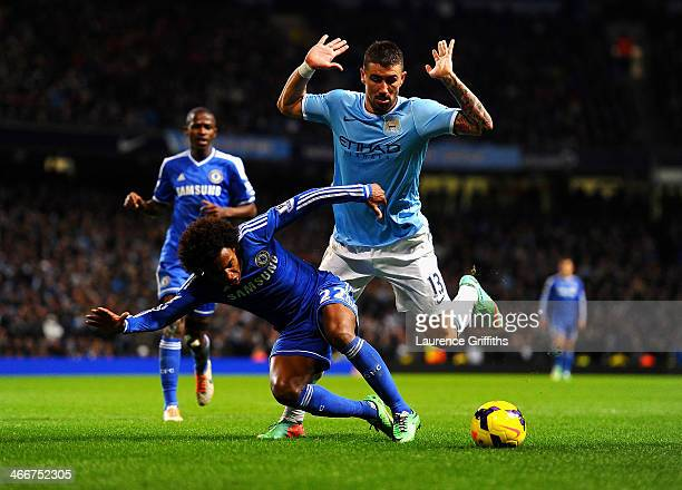 Willian of Chelsea tackles Aleksandar Kolarov of Manchester City during the Barclays Premier League match between Manchester City and Chelsea at...