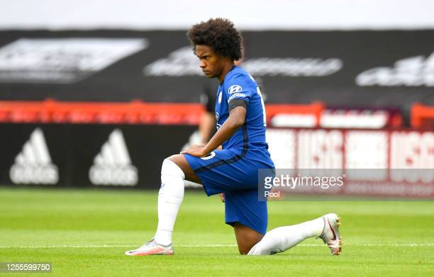 Willian of Chelsea takes a knee in support of the Black Lives Matter movement prior to the Premier League match between Sheffield United and Chelsea...