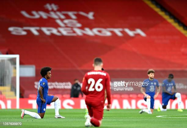 Willian of Chelsea takes a knee in support of the Black Lives Matter movement prior to the Premier League match between Liverpool FC and Chelsea FC...