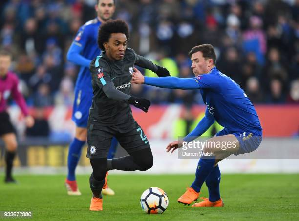 Willian of Chelsea takes on Ben Chilwell of Leicester City during The Emirates FA Cup Quarter Final match between Leicester City and Chelsea at The...