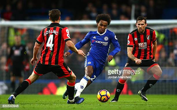 Willian of Chelsea takes on Dan Gosling of AFC Bournemouth during the Premier League match between Chelsea and AFC Bournemouth at Stamford Bridge on...