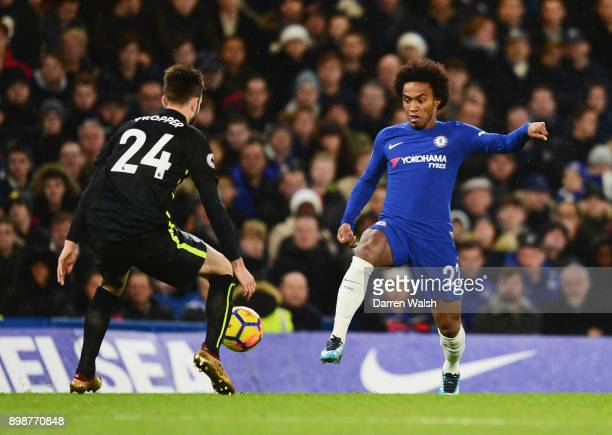 Willian of Chelsea takes on Davy Propper of Brighton and Hove Albion during the Premier League match between Chelsea and Brighton and Hove Albion at...