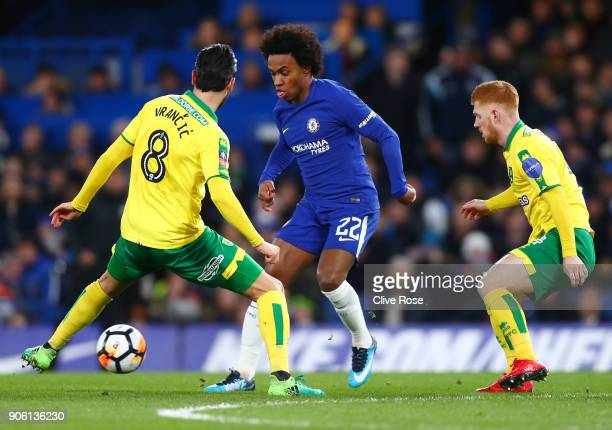 Willian of Chelsea takes on Mario Vrancic of Norwich City during The Emirates FA Cup Third Round Replay between Chelsea and Norwich City at Stamford...