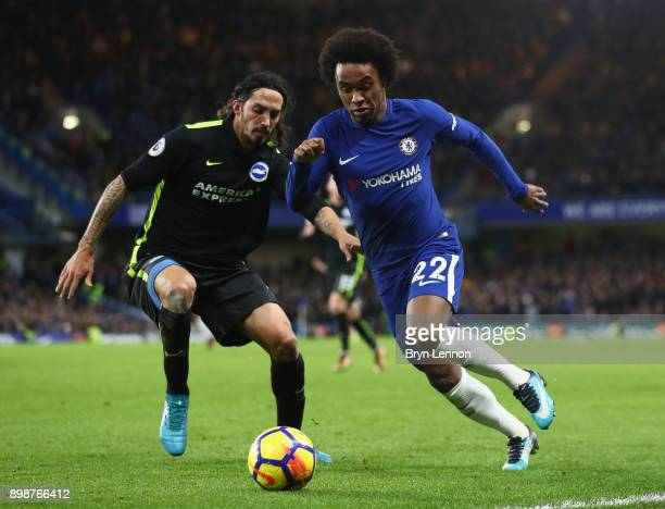 Willian of Chelsea takes on Matias Ezequiel Schelotto of Brighton and Hove Albion during the Premier League match between Chelsea and Brighton and...