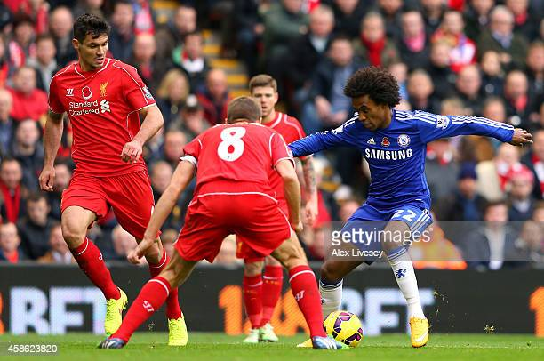 Willian of Chelsea takes on Steven Gerrard of Liverpool during the Barclays Premier League match between Liverpool and Chelsea at Anfield on November...