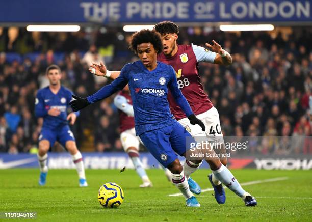 Willian of Chelsea turns away from Tyrone Mings of Aston Villa during the Premier League match between Chelsea FC and Aston Villa at Stamford Bridge...