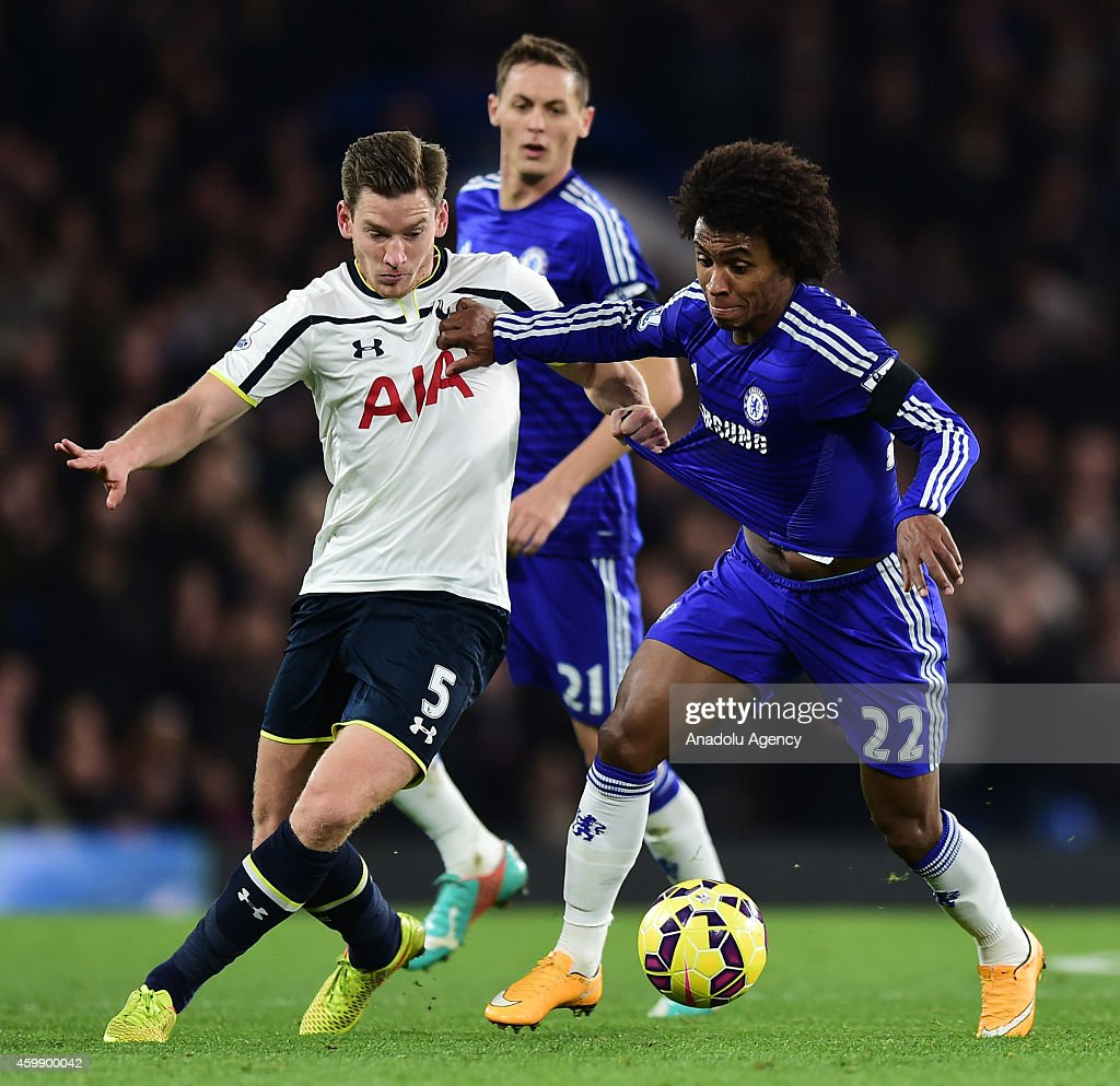 Willian (R) of Chelsea vies with Jan Vertonghen of Tottenham Hotspur (R) during the Barclays Premier League match between Chelsea and Tottenham Hotspur at Stamford Bridge in London, England on December 03, 2014.