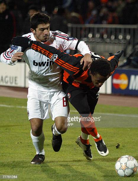 Willian of FC Shakhtar vies with Gennaro Gattuso of AC Milan during their UEFA Champion's League Group D football match in Donetsk 06 November 2007...