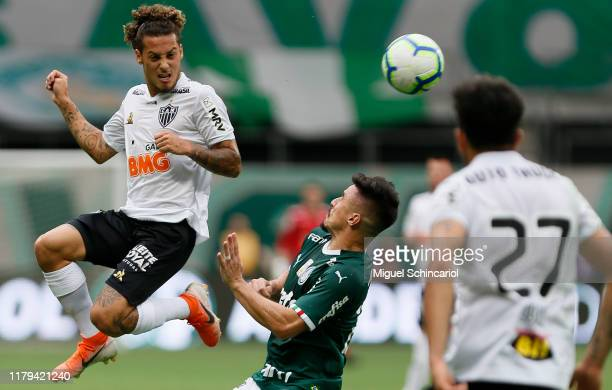 Willian of Palmeiras vies the ball with Guga of Atletico MG during a match between Palmeiras and Atletico MG for the Brasileirao Series A 2019 at...