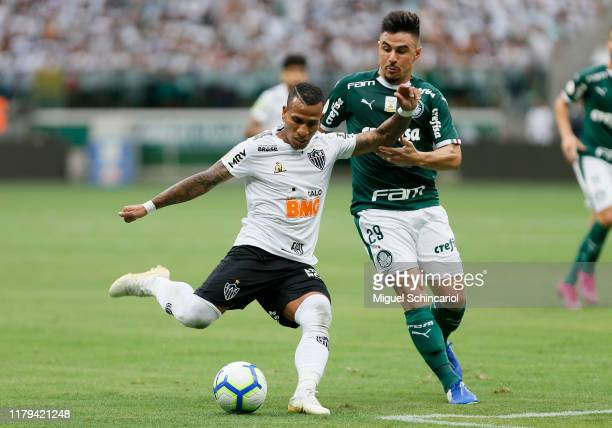 Willian of Palmeiras vies the ball with Otero of Atletico MG during a match between Palmeiras and Atletico MG for the Brasileirao Series A 2019 at...