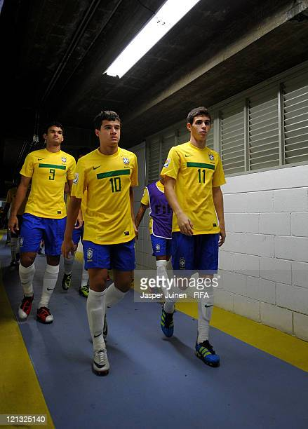 Willian Philippe Coutinho and Oscar of Brazil walk in the tunnel on their way to the pitch for the FIFA U20 World Cup Colombia 2011 semi final match...