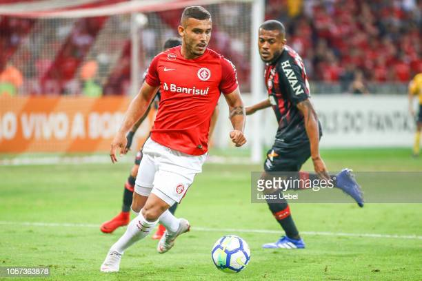 Willian Potker of Internacional battles for the ball against Marcelo Cirino of Atletico PR during the match between Internacional and Atletico PRas...