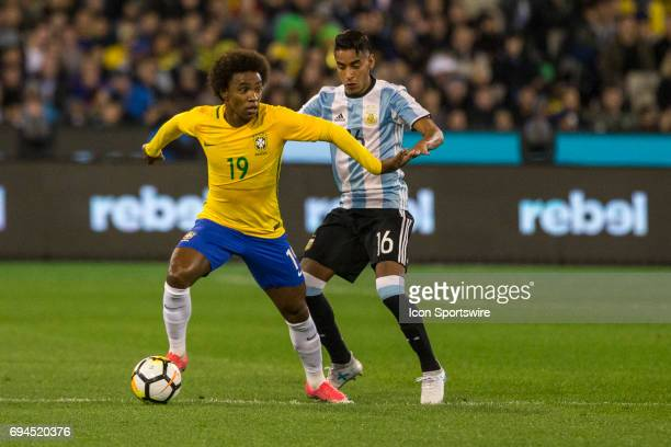 Willian Silva of the Brazilian National Football Team and Jose Luis Gomez of the Argentinan National Football Team contest the ball during the...