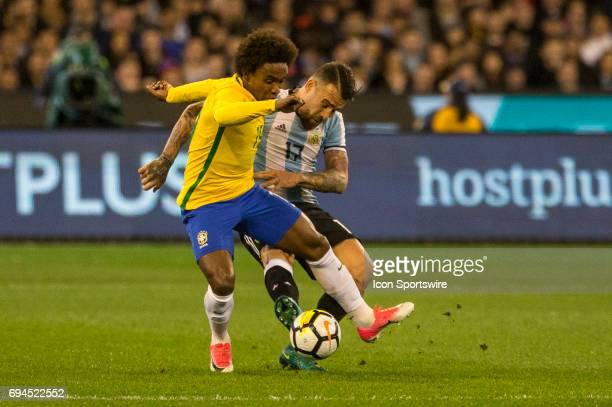 Willian Silva of the Brazilian National Football Team and Nicolas Otamendi of the Argentinan National Football Team contest the ball during the...