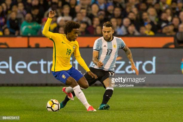 Willian Silva of the Brazilian National Football Team and Nicolas Otamendi of the Argentinan National Football Team contest the ball during the...
