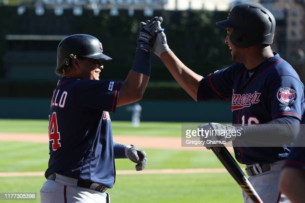 Willians Astudillo of the Minnesota Twins celebrates his eighth inning home run with Jonathan Schoop while playing the Detroit Tigers at Comerica...